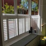 Café style box bay window shutters in Darwen, Lancashire